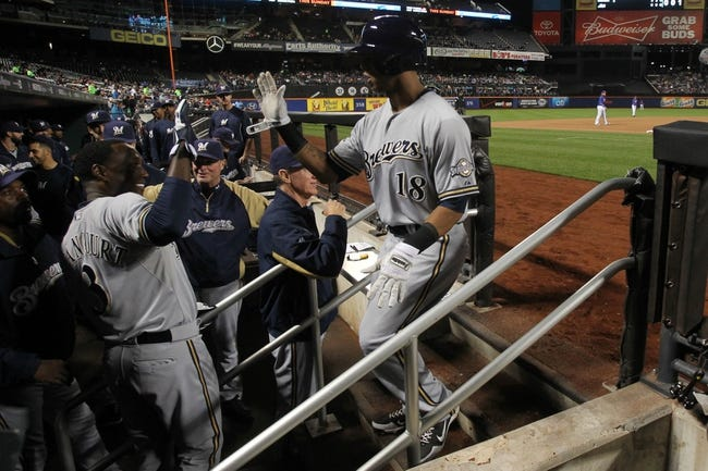 Sep 27, 2013; New York, NY, USA; Milwaukee Brewers left fielder Khris Davis (18) is congratulated in the dugout after hitting a two-run home run against the New York Mets during the first inning of a game at Citi Field. Mandatory Credit: Brad Penner-USA TODAY Sports
