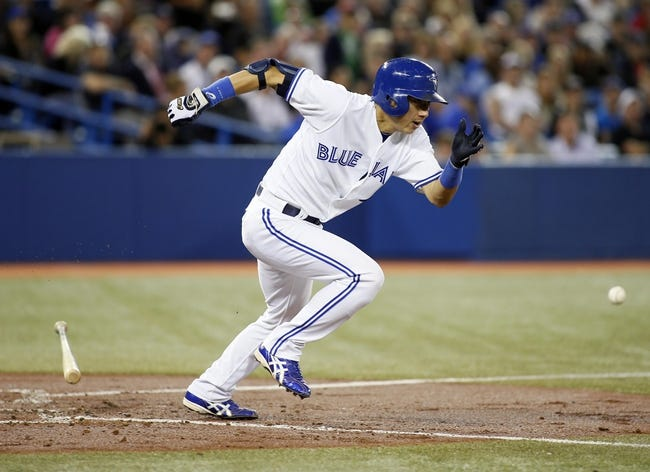 Sep 27, 2013; Toronto, Ontario, CAN; Toronto Blue Jays second baseman Munenori Kawasaki (66) bunts against the Tampa Bay Rays in the fourth inning at Rogers Centre. Mandatory Credit: John E. Sokolowski-USA TODAY Sports