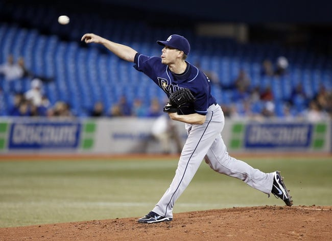 Sep 27, 2013; Toronto, Ontario, CAN; Tampa Bay Rays pitcher Jeremy Hellickson (58) throws against the Toronto Blue Jays in the fourth inning at Rogers Centre. Mandatory Credit: John E. Sokolowski-USA TODAY Sports