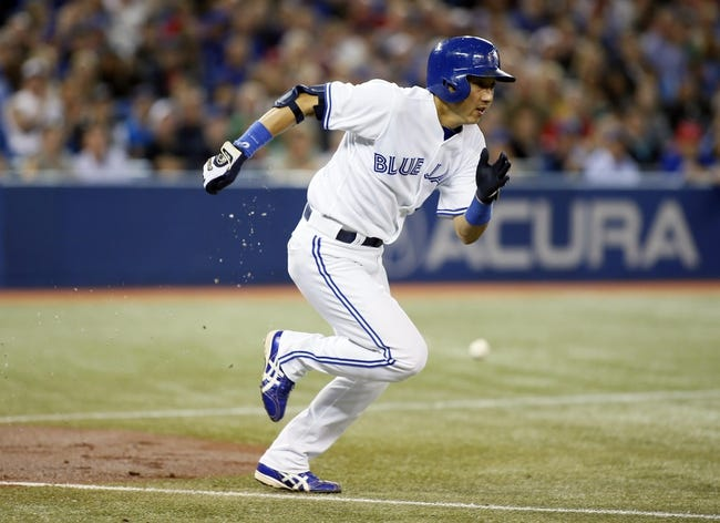Sep 27, 2013; Toronto, Ontario, CAN; Toronto Blue Jays second baseman Munenori Kawasaki (66) heads to first after a bunt against the Tampa Bay Rays in the fourth inning at Rogers Centre. Mandatory Credit: John E. Sokolowski-USA TODAY Sports