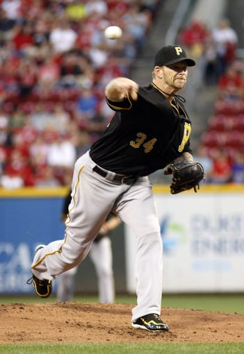 Sep 27, 2013; Cincinnati, OH, USA; Pittsburgh Pirates starting pitcher A.J. Burnett throws against the Cincinnati Reds in the first inning at Great American Ball Park. Mandatory Credit: David Kohl-USA TODAY Sports