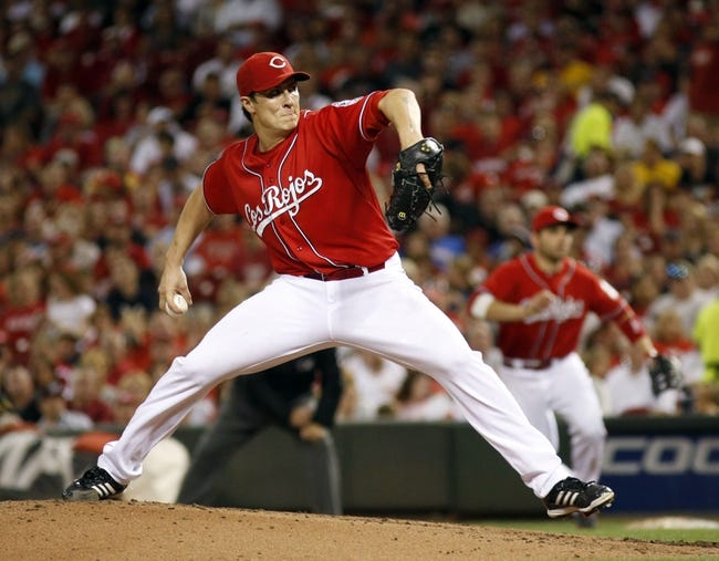 Sep 27, 2013; Cincinnati, OH, USA; Cincinnati Reds starting pitcher Homer Bailey throws a pitch against the Pittsburgh Pirates in the third inning at Great American Ball Park. Mandatory Credit: David Kohl-USA TODAY Sports
