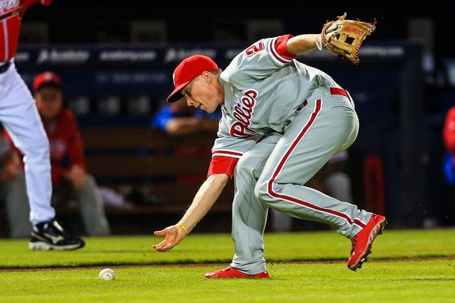 Sep 27, 2013; Atlanta, GA, USA; Philadelphia Phillies third baseman Cody Asche (25) fields a ground ball in the second inning against the Atlanta Braves at Turner Field. Mandatory Credit: Daniel Shirey-USA TODAY Sports