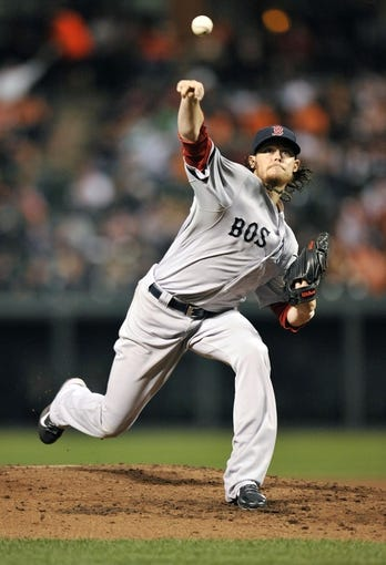 Sep 27, 2013; Baltimore, MD, USA; Boston Red Sox starting pitcher Clay Buchholz (11) throws the ball in the third inning against the Baltimore Orioles at Oriole Park at Camden Yards. Mandatory Credit: Joy R. Absalon-USA TODAY Sports