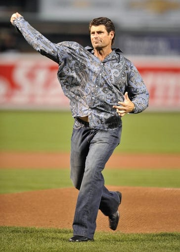 Sep 27, 2013; Baltimore, MD, USA; Former Baltimore Orioles pitcher Scott Erickson throws out the first pitch prior to the game between the Boston Red Sox and the Orioles at Oriole Park at Camden Yards. Mandatory Credit: Joy R. Absalon-USA TODAY Sports