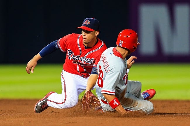 Sep 27, 2013; Atlanta, GA, USA; Atlanta Braves shortstop Andrelton Simmons (19) tags out Philadelphia Phillies center fielder Cesar Hernandez (16) on stolen base attempt in the sixth inning at Turner Field. Mandatory Credit: Daniel Shirey-USA TODAY Sports