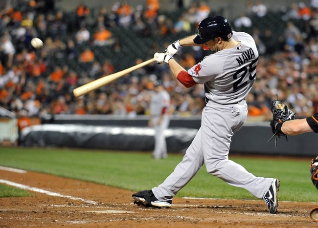 Sep 27, 2013; Baltimore, MD, USA; Boston Red Sox right fielder Daniel Nava (29) singles in the third inning against the Baltimore Orioles at Oriole Park at Camden Yards. Mandatory Credit: Joy R. Absalon-USA TODAY Sports