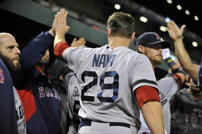 Sep 27, 2013; Baltimore, MD, USA; Boston Red Sox right fielder Daniel Nava (29) is congratulated by teammates after scoring in the third inning against the Baltimore Orioles at Oriole Park at Camden Yards. Mandatory Credit: Joy R. Absalon-USA TODAY Sports