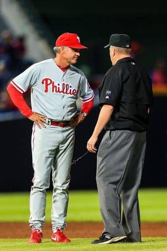 Sep 27, 2013; Atlanta, GA, USA; Philadelphia Phillies manager Ryne Sandberg (23) has a word with an umpire in the seventh inning against the Atlanta Braves at Turner Field. Mandatory Credit: Daniel Shirey-USA TODAY Sports