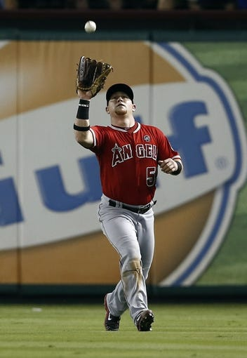 Sep 27, 2013; Arlington, TX, USA; Los Angeles Angels right fielder Kole Calhoun (56) catches a fly ball hit by Texas Rangers left fielder Craig Gentry (not pictured) during the second inning of a baseball game at Rangers Ballpark in Arlington. Mandatory Credit: Jim Cowsert-USA TODAY Sports