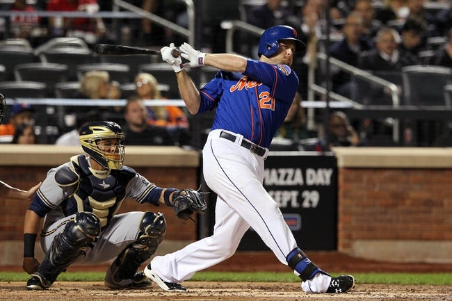Sep 27, 2013; New York, NY, USA; New York Mets left fielder Lucas Duda (21) hits a double against the Milwaukee Brewers during the third inning at Citi Field. Mandatory Credit: Brad Penner-USA TODAY Sports