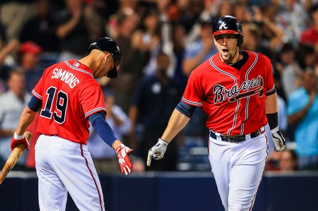 Sep 27, 2013; Atlanta, GA, USA; Atlanta Braves third baseman Chris Johnson (23) celebrates a solo home run with shortstop Andrelton Simmons (19) in the eighth inning against the Philadelphia Phillies at Turner Field. Mandatory Credit: Daniel Shirey-USA TODAY Sports
