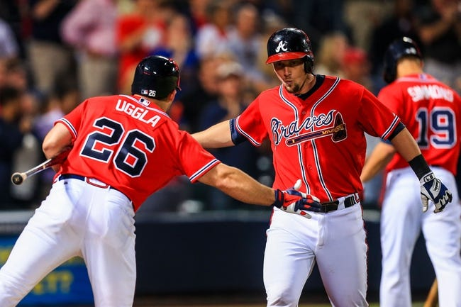 Sep 27, 2013; Atlanta, GA, USA; Atlanta Braves third baseman Chris Johnson (23) celebrates a solo home run with second baseman Dan Uggla (26) in the eighth inning against the Philadelphia Phillies at Turner Field. Mandatory Credit: Daniel Shirey-USA TODAY Sports