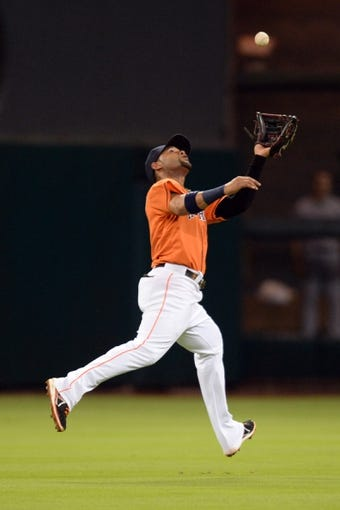 Sep 27, 2013; Houston, TX, USA; Houston Astros shortstop Jonathan Villar (6) catches a shallow fly ball against the New York Yankees during the fourth inning at Minute Maid Park. Mandatory Credit: Thomas Campbell-USA TODAY Sports