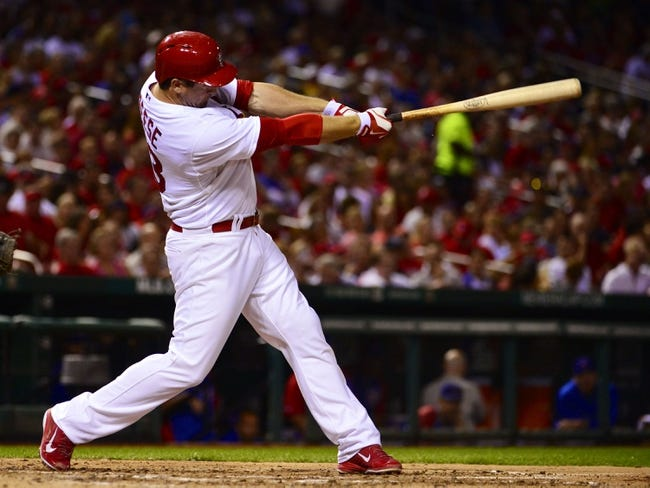 Sep 27, 2013; St. Louis, MO, USA; St. Louis Cardinals third baseman David Freese (23) hits a solo home run against the Chicago Cubs during the third inning at Busch Stadium. Mandatory Credit: Scott Rovak-USA TODAY Sports