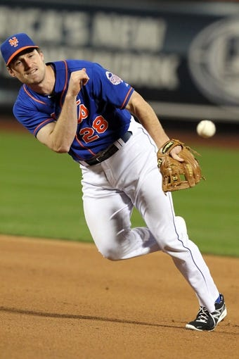 Sep 27, 2013; New York, NY, USA; New York Mets second baseman Daniel Murphy (28) throws out Milwaukee Brewers left fielder Khris Davis (not pictured) during the eighth inning at Citi Field. The Brewers won 4-2. Mandatory Credit: Brad Penner-USA TODAY Sports