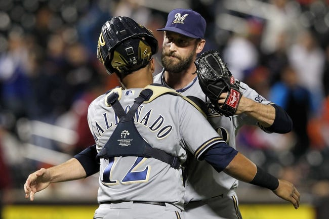 Sep 27, 2013; New York, NY, USA; Milwaukee Brewers catcher Martin Maldonado (12) and relief pitcher Jim Henderson (29) celebrate after defeating the New York Mets 4-2 at Citi Field. Mandatory Credit: Brad Penner-USA TODAY Sports