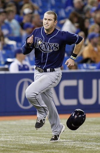 Sep 27, 2013; Toronto, Ontario, CAN; Tampa Bay Rays third baseman Evan Longoria (3) scores in the ninth inning against the Toronto Blue Jays at Rogers Centre. Toronto defeated Tampa Bay 6-3. Mandatory Credit: John E. Sokolowski-USA TODAY Sports