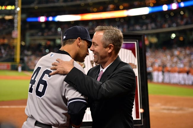 Sep 27, 2013; Houston, TX, USA; Houston Astros president Reid Ryan hugs New York Yankees starting pitcher Andy Pettitte (46) during the fifth inning at Minute Maid Park. Mandatory Credit: Thomas Campbell-USA TODAY Sports