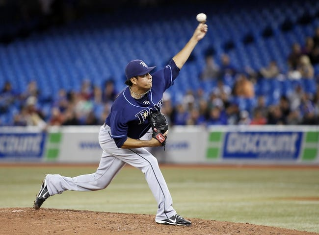 Sep 27, 2013; Toronto, Ontario, CAN; Tampa Bay Rays pitcher Cesar Ramos (27) throws against the Toronto Blue Jays in the seventh inning at Rogers Centre. Toronto defeated Tampa Bay 6-3. Mandatory Credit: John E. Sokolowski-USA TODAY Sports