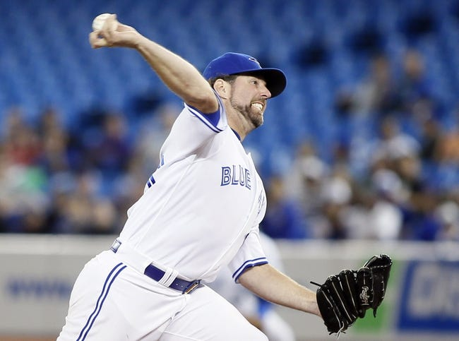 Sep 27, 2013; Toronto, Ontario, CAN; Toronto Blue Jays pitcher R.A. Dickey (43) pitches during the game against the Tampa Bay Rays at Rogers Centre. Toronto defeated Tampa Bay 6-3. Mandatory Credit: John E. Sokolowski-USA TODAY Sports