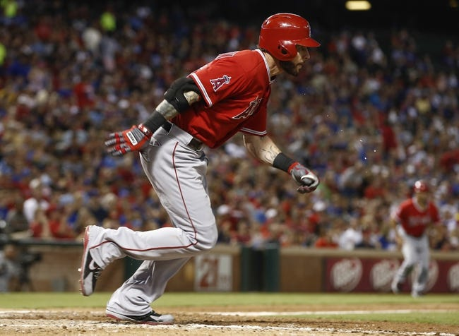 Sep 27, 2013; Arlington, TX, USA; Los Angeles Angels center fielder Josh Hamilton (32) runs towards first base on a two run RBI against the Texas Rangers during the fifth inning at Rangers Ballpark. Hamilton collected his one thousandth career hit during this at bat. Mandatory Credit: Jim Cowsert-USA TODAY Sports