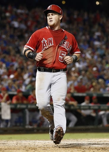 Sep 27, 2013; Arlington, TX, USA; Los Angeles Angels right fielder Kole Calhoun (56) scores a run against the Texas Rangers during the fifth inning at Rangers. Mandatory Credit: Jim Cowsert-USA TODAY Sports
