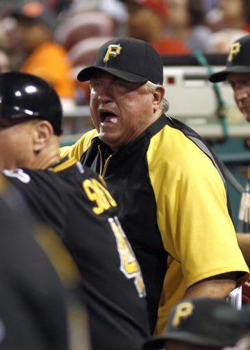Sep 27, 2013; Cincinnati, OH, USA; Pittsburgh Pirates manager Clint Hurdle reacts to a call in the ninth inning against the Cincinnati Reds at Great American Ball Park. Pittsburgh won 4-1. Mandatory Credit: David Kohl-USA TODAY Sports
