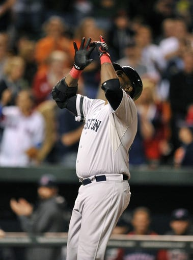 Sep 27, 2013; Baltimore, MD, USA; Boston Red Sox designated hitter David Ortiz (34) celebrates after hitting a three-run home run in the eighth inning against the Baltimore Orioles at Oriole Park at Camden Yards. The Red Sox defeated the Orioles 12-3. Mandatory Credit: Joy R. Absalon-USA TODAY Sports