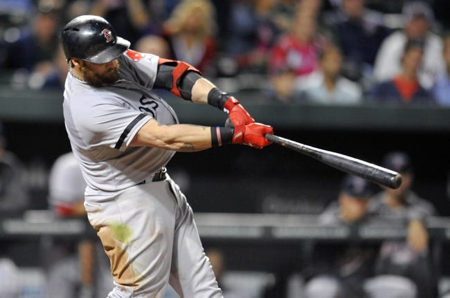 Sep 27, 2013; Baltimore, MD, USA; Boston Red Sox left fielder Jonny Gomes (5) hits a solo home run in the ninth inning against the Baltimore Orioles at Oriole Park at Camden Yards. The Red Sox defeated the Orioles 12-3. Mandatory Credit: Joy R. Absalon-USA TODAY Sports