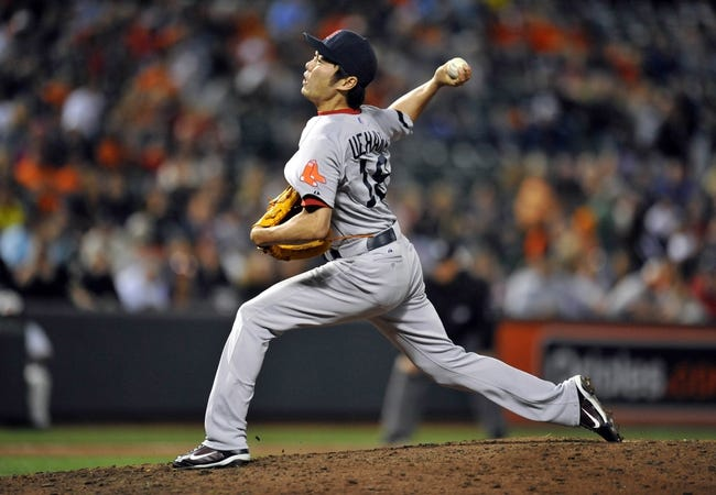 Sep 27, 2013; Baltimore, MD, USA; Boston Red Sox pitcher Koji Uehara (19) throws in the ninth inning against the Baltimore Orioles at Oriole Park at Camden Yards. The Red Sox defeated the Orioles 12-3. Mandatory Credit: Joy R. Absalon-USA TODAY Sports