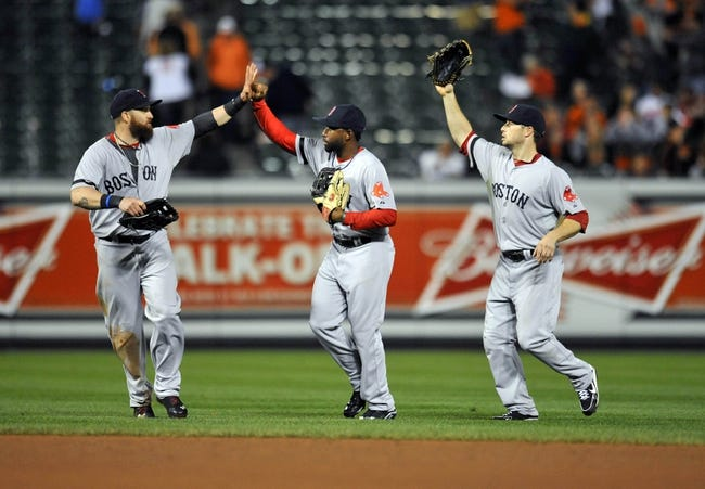 Sep 27, 2013; Baltimore, MD, USA; Boston Red Sox outfielders Jonny Gomes (left), Jackie Bradley Jr (center) and Daniel Nava (right) celebrate after a game against the Baltimore Orioles at Oriole Park at Camden Yards. The Red Sox defeated the Orioles 12-3. Mandatory Credit: Joy R. Absalon-USA TODAY Sports
