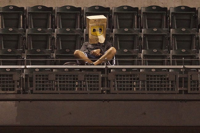 Sep 27, 2013; Seattle, WA, USA; A fan sits in the upper right field stands during the second inning of a game between the Oakland Athletics and the Seattle Mariners at Safeco Field. Mandatory Credit: Joe Nicholson-USA TODAY Sports