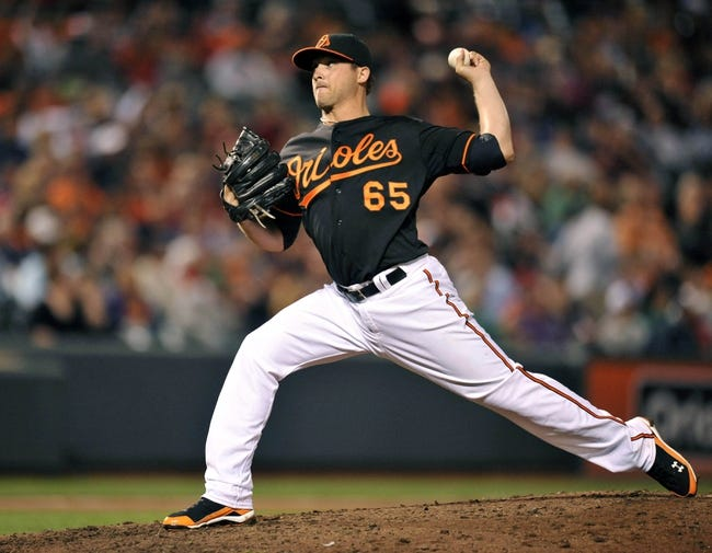 Sep 27, 2013; Baltimore, MD, USA; Baltimore Orioles pitcher Mike Belfiore (65) makes his major league debut in the eighth inning against the Boston Red Sox at Oriole Park at Camden Yards. The Red Sox defeated the Orioles 12-3. Mandatory Credit: Joy R. Absalon-USA TODAY Sports