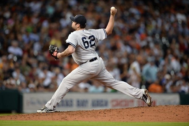 Sep 27, 2013; Houston, TX, USA; New York Yankees relief pitcher Joba Chamberlain (62) pitches against the Houston Astros during the seventh inning at Minute Maid Park. Mandatory Credit: Thomas Campbell-USA TODAY Sports