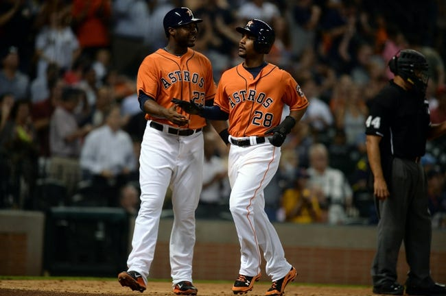 Sep 27, 2013; Houston, TX, USA; Houston Astros first baseman Chris Carter (23) and right fielder L.J. Hoes (28) celebrate scoring runs against the New York Yankees during the seventh inning at Minute Maid Park. Mandatory Credit: Thomas Campbell-USA TODAY Sports