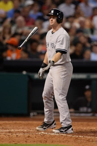 Sep 27, 2013; Houston, TX, USA; New York Yankees third baseman David Adams (45) reacts to striking out against the Houston Astros during the ninth inning at Minute Maid Park. The Yankees won 3-2. Mandatory Credit: Thomas Campbell-USA TODAY Sports