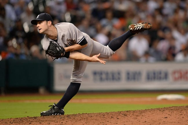 Sep 27, 2013; Houston, TX, USA; New York Yankees relief pitcher David Robertson (30) pitches against the Houston Astros during the ninth inning at Minute Maid Park. The Yankees won 3-2. Mandatory Credit: Thomas Campbell-USA TODAY Sports