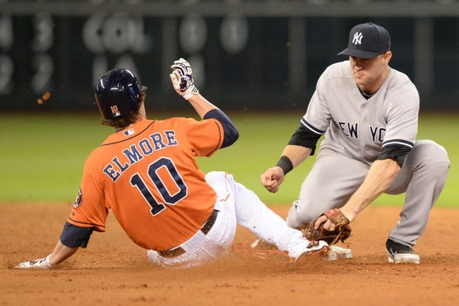 Sep 27, 2013; Houston, TX, USA; New York Yankees second baseman David Adams (45) tags out Houston Astros shortstop Jake Elmore (10) on a steal attempt during the eighth inning at Minute Maid Park. The Yankees won 3-2. Mandatory Credit: Thomas Campbell-USA TODAY Sports