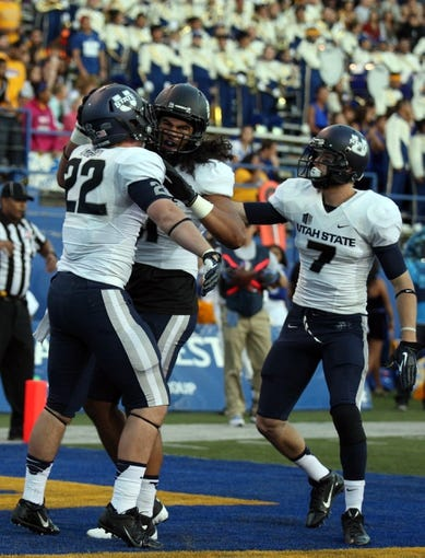 Sep 27, 2013; San Jose, CA, USA; Utah State Aggies tight end Keegan Andersen (22) celebrates with tight end D.J. Tialavea (91) after scoring a touchdown against the San Jose State Spartans during the first quarter at Spartan Stadium. Mandatory Credit: Kelley L Cox-USA TODAY Sports