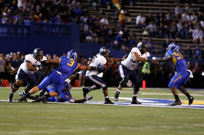 Sep 27, 2013; San Jose, CA, USA; San Jose State Spartans defensive tackle Travis Raciti (3) and defensive tackle Foloi Vae (93) combine to sack Utah State Aggies quarterback Chuckie Keeton (16) during the second quarter at Spartan Stadium. Mandatory Credit: Kelley L Cox-USA TODAY Sports