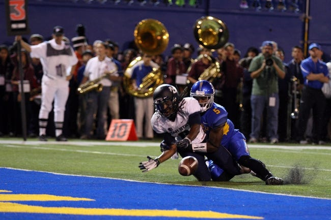 Sep 27, 2013; San Jose, CA, USA; San Jose State Spartans cornerback Dasheon Frierson (5) prevents the pass intended for Utah State Aggies wide receiver Travis Reynolds (8) during the second quarter at Spartan Stadium. Mandatory Credit: Kelley L Cox-USA TODAY Sports
