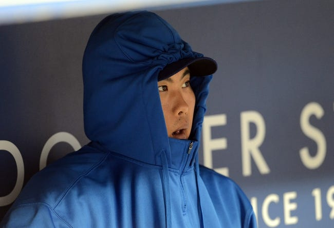 Sep 27, 2013; Los Angeles, CA, USA; Los Angeles Dodgers starting pitcher Hyun-Jin Ryu (99) sits in the dugout prior to the game against the Colorado Rockies at Dodger Stadium. Mandatory Credit: Jayne Kamin-Oncea-USA TODAY Sports