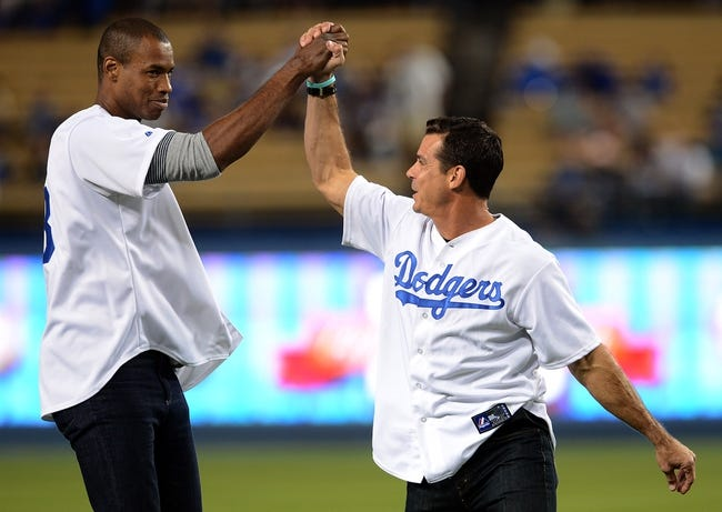 Sep 27, 2013; Los Angeles, CA, USA; NBA player Jason Collins and former Los Angeles Dodgers Billy Bean celebrate after throwing out the first pitch at the first annual LGBT Night Out at Dodger Stadium prior to the game against the Los Angeles Dodgers and the Colorado Rockies. Mandatory Credit: Jayne Kamin-Oncea-USA TODAY Sports