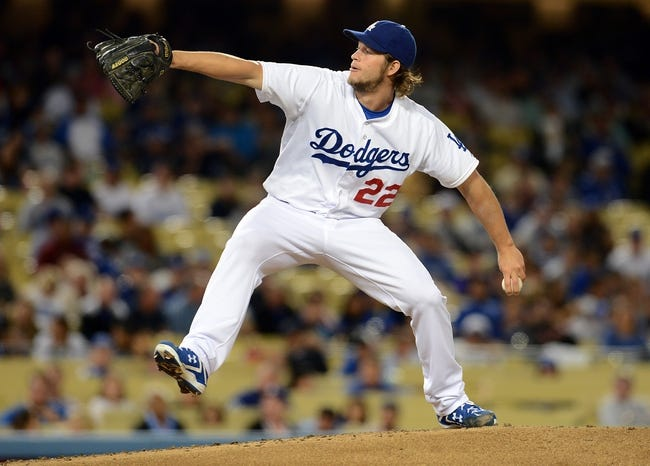 Sep 27, 2013; Los Angeles, CA, USA;  Los Angeles Dodgers starting pitcher Clayton Kershaw (22) throws the ball against the Colorado Rockies at Dodger Stadium. Mandatory Credit: Jayne Kamin-Oncea-USA TODAY Sports