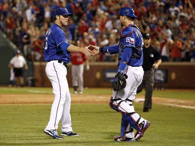 Sep 27, 2013; Arlington, TX, USA; Texas Rangers relief pitcher Joe Nathan (left) and catcher A.J. Pierzynski (right) congratulate each other following their win against the Los Angeles Angels in a baseball game at Rangers Ballpark in Arlington. The Rangers won 5-3. Mandatory Credit: Jim Cowsert-USA TODAY Sports