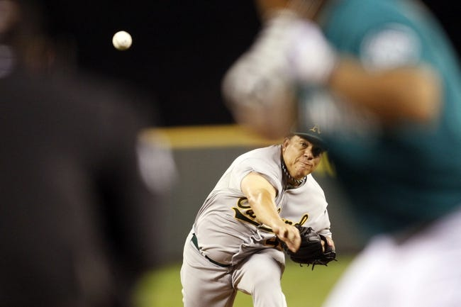 Sep 27, 2013; Seattle, WA, USA; Oakland Athletics pitcher Bartolo Colon (40) throws against the Seattle Mariners during the fifth inning at Safeco Field. Mandatory Credit: Joe Nicholson-USA TODAY Sports