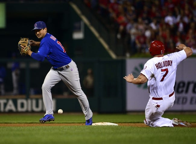 Sep 27, 2013; St. Louis, MO, USA; Chicago Cubs second baseman Darwin Barney (15) drops the ball while attempting to turn a double play over St. Louis Cardinals left fielder Matt Holliday (7) at Busch Stadium. The Cardinals defeated the Cubs 7-0 to win the National League Central Title. Mandatory Credit: Scott Rovak-USA TODAY Sports
