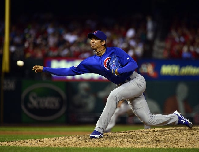 Sep 27, 2013; St. Louis, MO, USA; Chicago Cubs relief pitcher Chang-Yong Lim (12) delivers a pitch against the St. Louis Cardinals at Busch Stadium. The Cardinals defeated the Cubs 7-0 to win the National League Central Title. Mandatory Credit: Scott Rovak-USA TODAY Sports