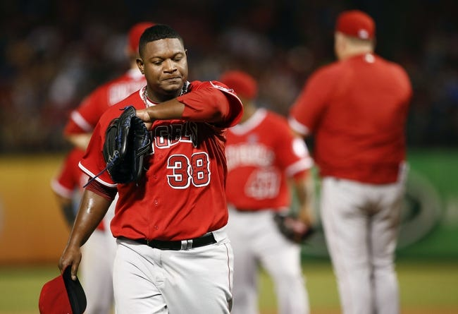 Sep 27, 2013; Arlington, TX, USA; Los Angeles Angels relief pitcher J.C. Gutierrez (38) departs the game after being relieved against the Texas Rangers during the seventh inning at Rangers Ballpark in Arlington. The Rangers won 5-3. Mandatory Credit: Jim Cowsert-USA TODAY Sports